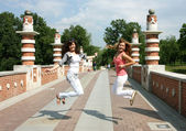 Girls jumping on the bridge — Stock Photo
