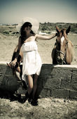 Young woman with horses — Stock Photo