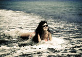 Young girl in the sea waves — Photo