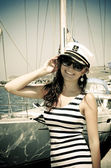 Young woman in captain cap — Stockfoto