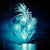 Celebratory blue firework in sky — Stock Photo