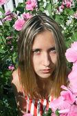 Beautiful girl in flowers — Stock Photo