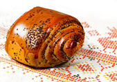 Fresh baked  bun with poppy-seed — Stock Photo
