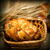 Fresh baked bread with wheat — Stock Photo