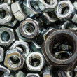 Macro metal nuts with a difference. — Stock Photo