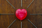Red heart and needles. — Stock Photo
