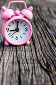 Small pink watch on wood.  — Stock Photo
