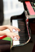Playing piano.  — Stockfoto