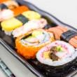 Sushi with chopsticks. — Stock Photo