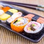 Sushi with chopsticks. — Stock Photo #43785993