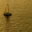 Sailing yacht boat on golden tropical sea. — Stock Photo