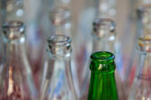Empty green and white glass bottles. — Stockfoto