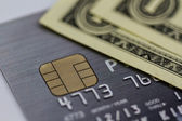 Secure chip of credit card cover with dollar banknotes. — Stock Photo