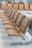 Empty bench in departure flights waiting hall. — Stock Photo