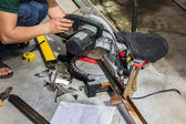 Worker cutting steel tube. — Stock Photo