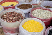Selection of various legumes in basket for sale at market. — Stockfoto