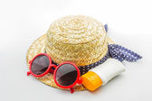 Woven hat, red sunglasses with body lotion. — Stock Photo