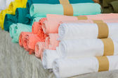 Row of variety multicolored shirt clothes hanging on shelf outdo — Stock Photo