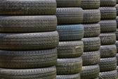 Stack of old wheel black tyres. — Stok fotoğraf