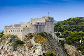 Ancient fortress situated on a cliff — Stock Photo