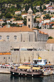 Fortress wall and bell tower of the old city — Stock Photo