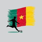 背景があるカメルーン共和国旗とサッカー プレーヤーのアクション — ストックベクタ