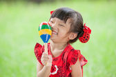 Little Asian girl playing percussion — Stock Photo