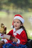 Little girl enjoy dressing as santa — Stock Photo