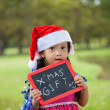 Little Asian girl with santa hat — Stock Photo