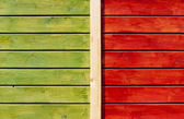 Wooden wall painted in green and bright orange — Stock Photo