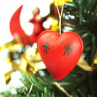 Red heart close-up on Christmas tree  — Stockfoto