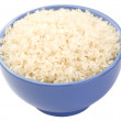 Boiled long grain rice in lilac bowl close-up isolated — Stock Photo #34439953