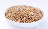 Bowl of boiled buckwheat close-up — Stock Photo