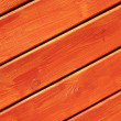 Wooden wall painted in bright orange  — Stock Photo
