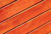 Wooden wall painted in bright orange — Stockfoto