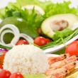 Rice, shrimps and vegetables on white dishes — Stock Photo