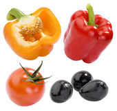 Yellow and red peppers, red tomato and black olives isolated — Stock Photo