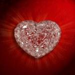 Diamonds heart shaped gemstone isolated on red velvet background — Stock Photo #39463853