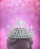 Diamonds crown on women head in pink glitter background — Stockfoto