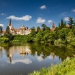 Castle with reflection in pond and blue sky - Pruhonice, Czech Republic — Stock Photo #32436111