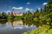 Castle with reflection in pond and blue sky - Pruhonice, Czech Republic — Stock Photo