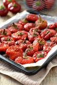 Roasted red peppers on a baking tray — Stock Photo