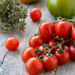 Tomatoes and oregano — Stock Photo