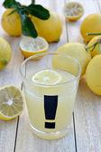 Freshly squeezed lemon juice. Close up. — Stock Photo