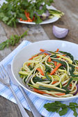 Pasta with arugula and julienne vegetables — Stock Photo