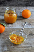 Orange marmalade in a jar with spoon — Stock Photo