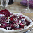 Marinated anchovies with salad of radicchio lettuce and beets — Stock Photo