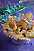 Chiacchiere, carnival fried pastries. Italian food. — Stock Photo
