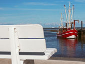 Empty bank in a harbour in the north of Germany. — Stock Photo
