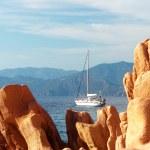 Rocky landscape with yacht at Corsica — Stok fotoğraf